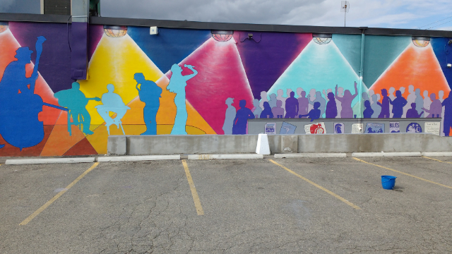 colourful mural of live music painted on wall
